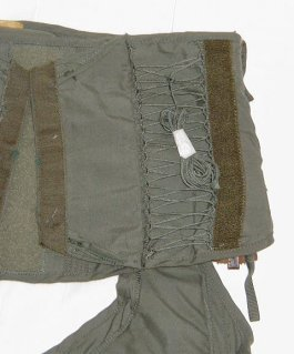 G-suit Adjustment or strings in back to adjust size - Model CSU-13B/P - also known as anti-g suit or anti-gravity garment usually worn by military fighter pilot - shown for medical use